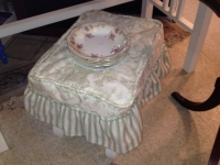 green-upholstered-footstool